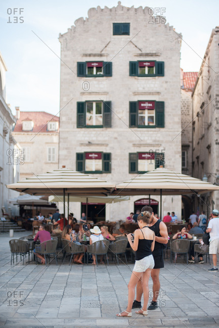 Dubrovnik, Croatia - July 22, 2015: People in the street and dining at an outdoor restaurant in Dubrovnik, Croatia