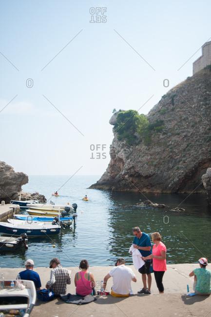 Dubrovnik, Croatia - July 22, 2015: People sitting on the coast of Dubrovnik, Croatia