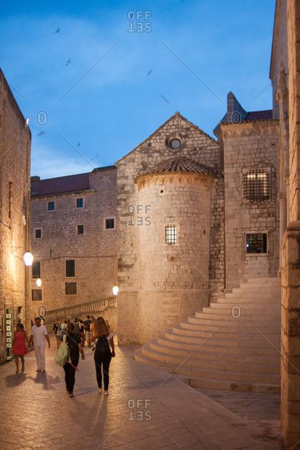 Dubrovnik, Croatia - July 22, 2015: People walking at dusk in Old Town Dubrovnik, Croatia