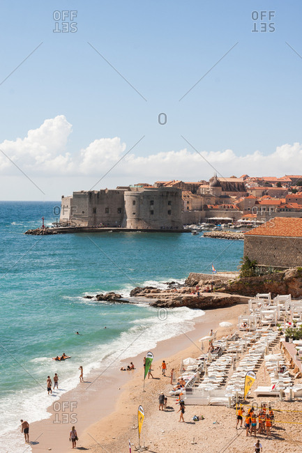 Dubrovnik, Croatia - July 22, 2015: Beachgoers on a beach in Dubrovnik, Croatia