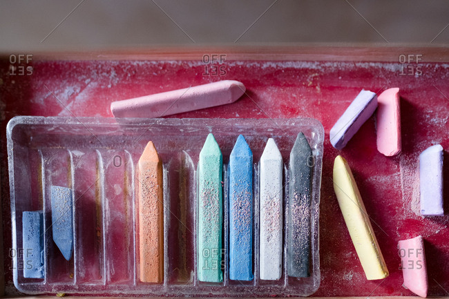 Pieces of colored chalk in tray