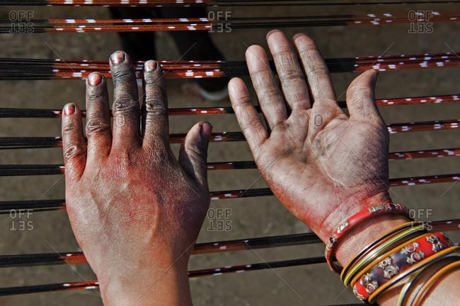 India, Orissa, Badbadi weaver village, Baragarh district, hands stained with dye