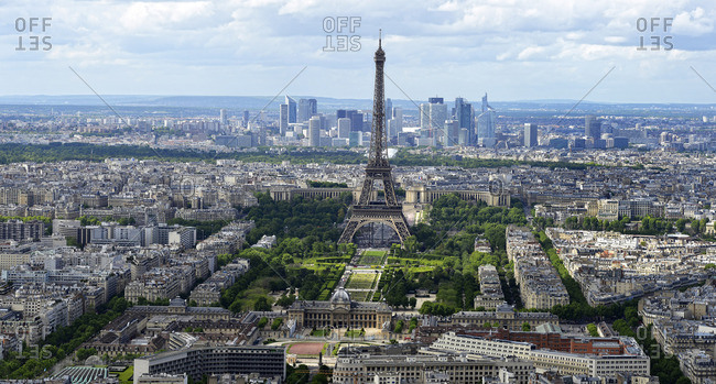 France, Paris - May 9, 2014: Aerial and panoramic view of Paris, Eiffel Tower in front of the towers of La DZfense.