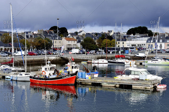 North-Western France - September 30, 2014: Deep sea port at the foot of the battlements of the walled town, boats