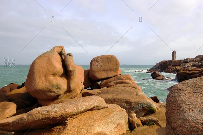 France, North-Western France, Brittany, Ploumanach, pink granite coast and the lighthouse in the background