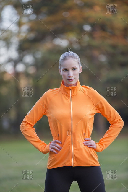 Portrait of a pretty blonde woman doing sport in park looking at camera