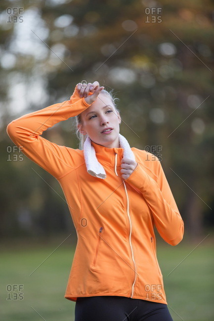 Pretty blonde woman exhausted after doing sport in park