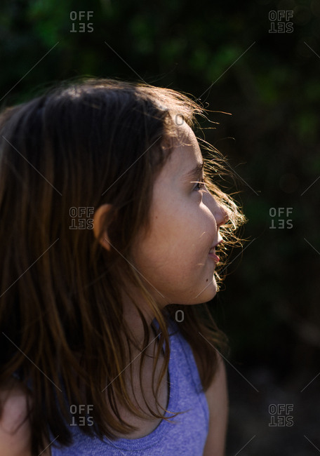 Portrait of a little girl looking away