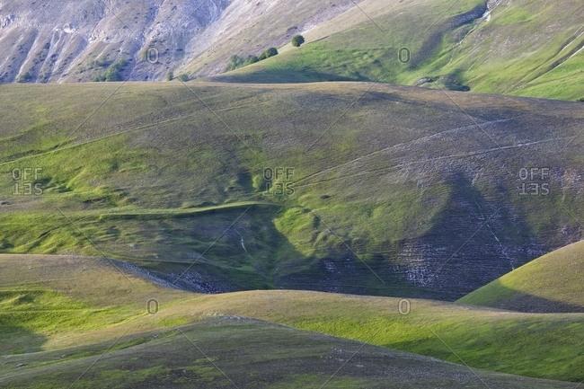 Rolling landscape of Monte Vettore in spring, Castelluccio di Norcia, Italy