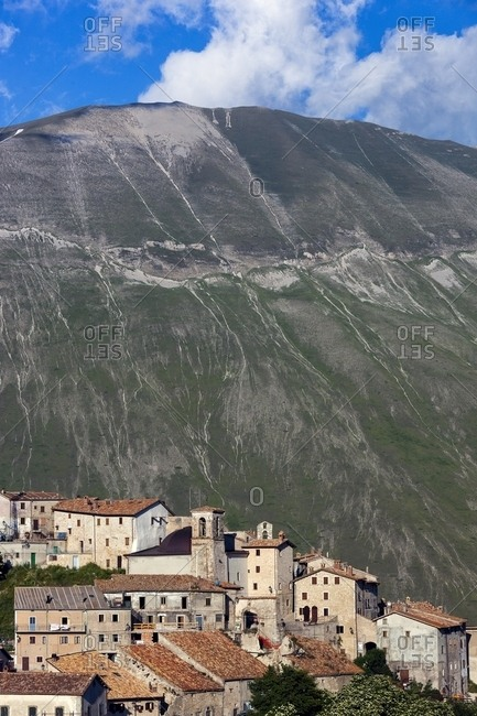 The olf village of Castelluccio di Norcia before the disastrous earthquake of 2016 ant in the background the mount Vettore and its fault, Italy