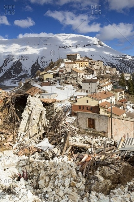 Castelluccio di Norcia, the old village destroyed by the earthquake of 2016, in the background the Vettore mountain and its fault, Sibillini national park, Italy