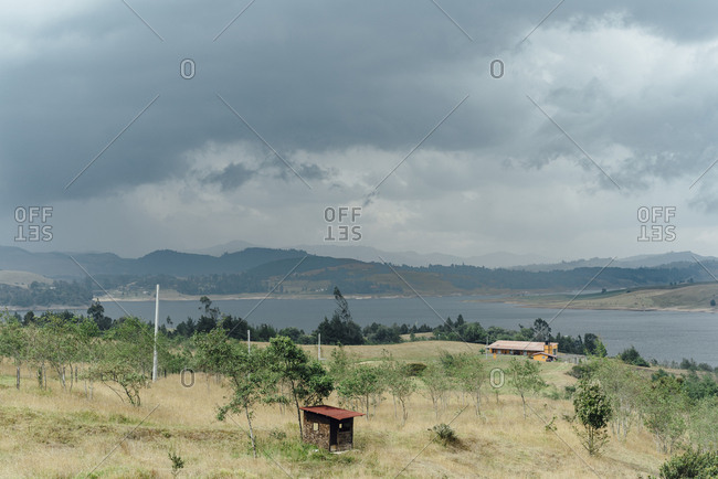 Front view of Guatavita lake in Represa del Sisga, Colombia