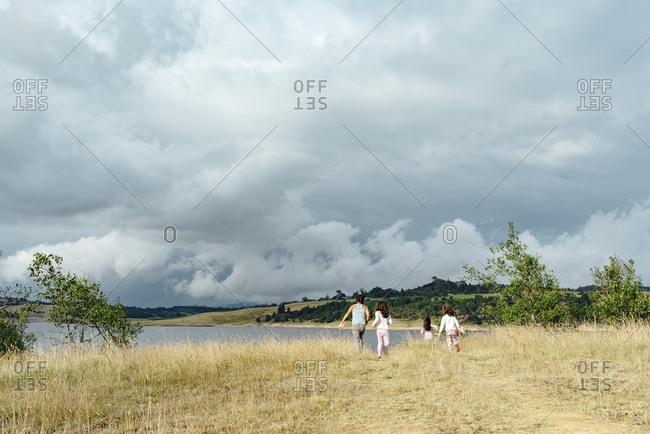 Girls walking together to Guatavita lake in Represa del Sisga, Colombia