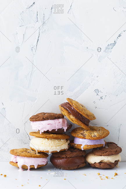 Ice cream cookies stacked on top of one another on a marble background