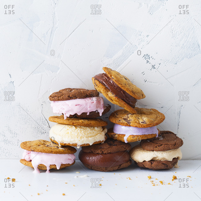 Close up of ice cream cookies stacked on top of one another on a marble background