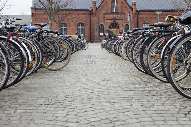 Rows of bikes parked on cobblestone street in Aarhus, Denmark