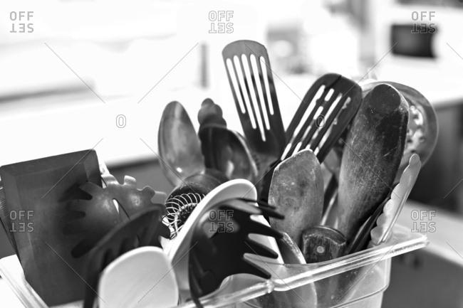 Kitchen utensils in plastic dishes