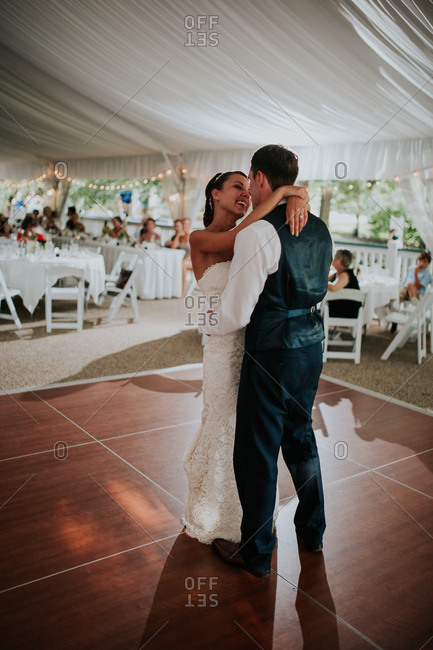 Bride with groom during their first dance