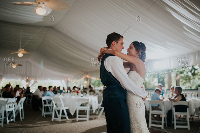 Bride with groom during first dance