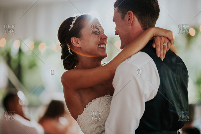 Bride with groom in their first dance