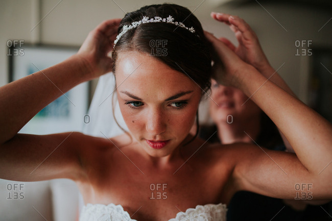 Bride getting help with veil