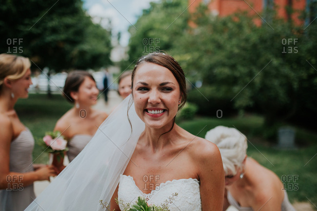 Excited bride standing outside
