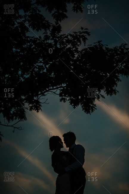 Bride and groom in a loving silhouette