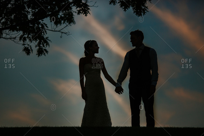 Bride and groom in loving silhouette