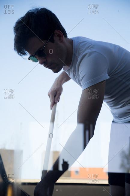Man cleaning his terrace