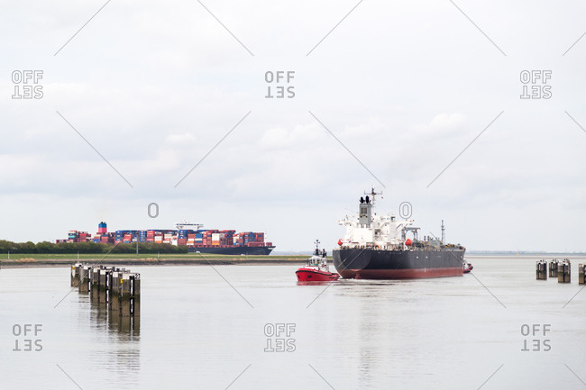 April 1, 2017: A tug boat leading freight ship