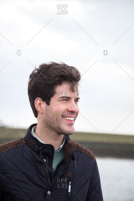 Man in quilted light coat