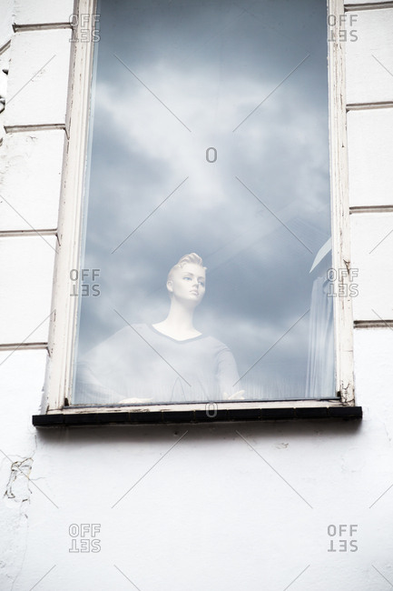 Female mannequin seen in window