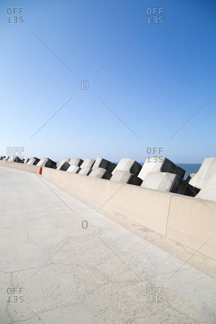 A concrete walkway along coast