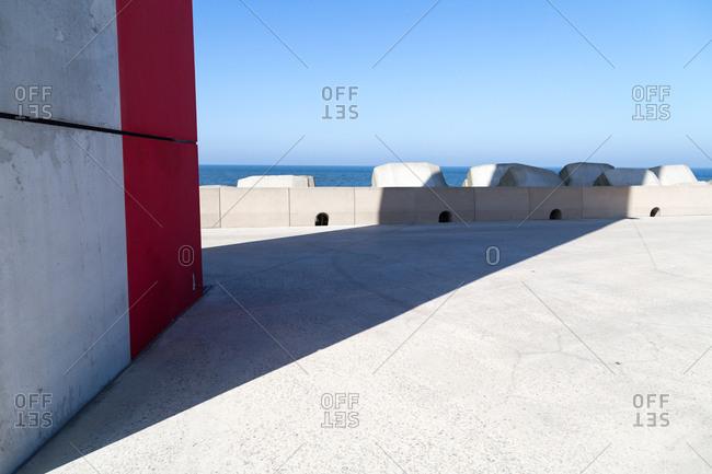 Building shadow on concrete pier
