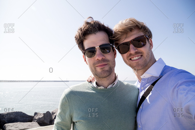 Young caucasian men on pier