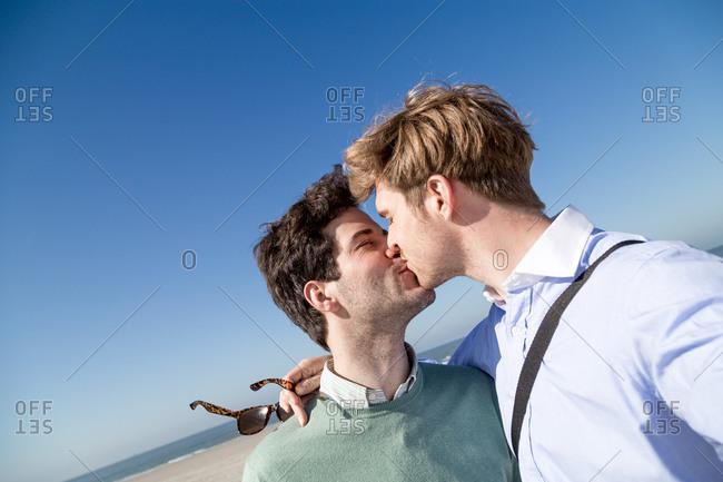 Gay couple kissing in selfie