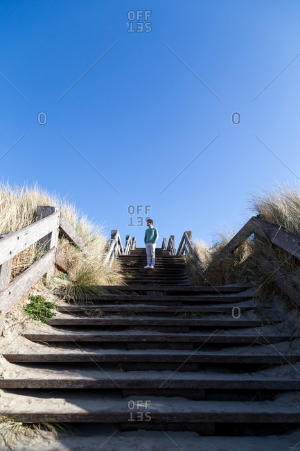 A man on set of coastal stairs