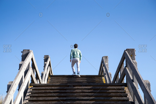A man going up coastal stairs