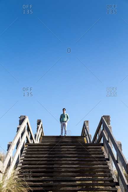 A man on top of coastal steps