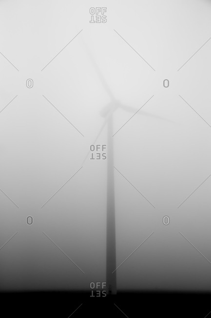 A wind turbine in the fog