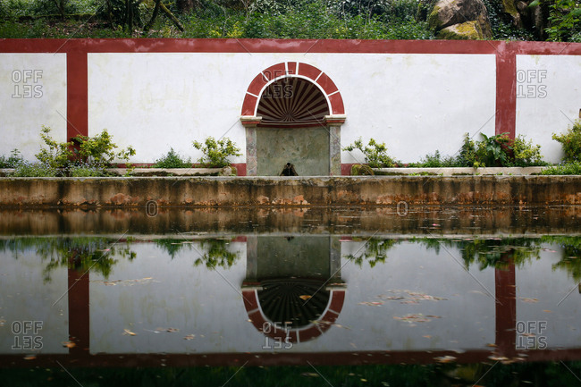 Building reflecting in lake in the Sintra Mountains