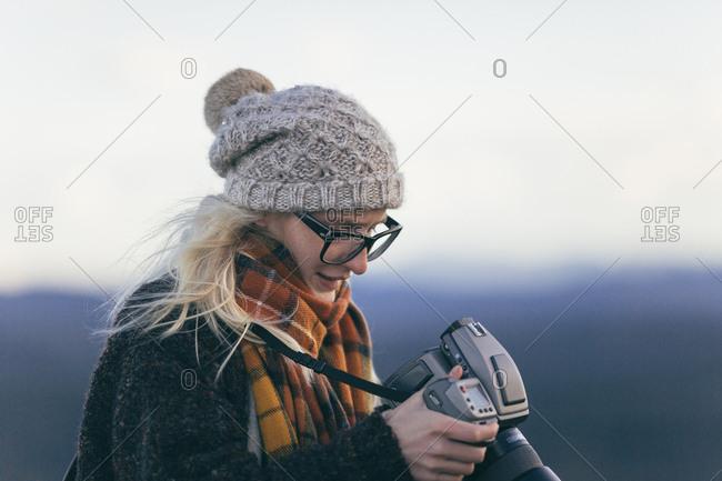 Blonde woman looking at a camera