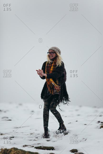 Blonde woman balling up snowball