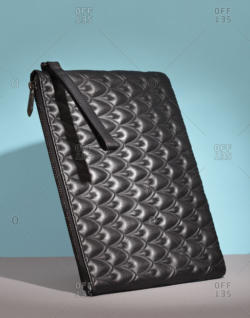 Woman's black patterned clutch bag