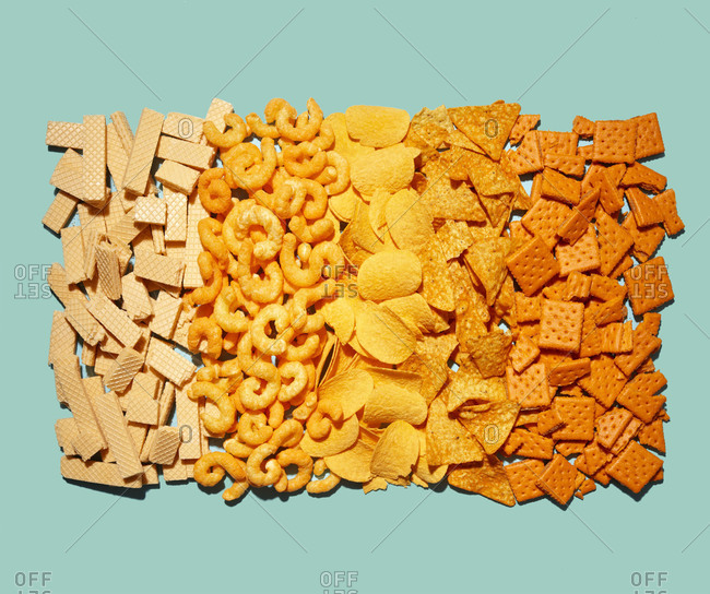 Rows of various orange-colored snack food