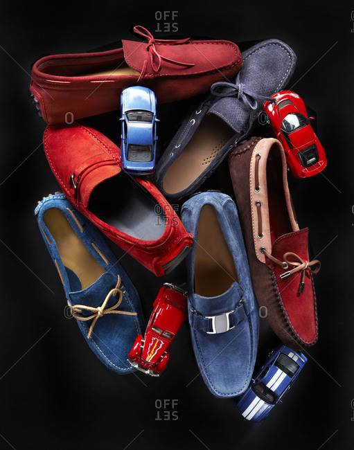 Red and blue men's loafers and toy cars