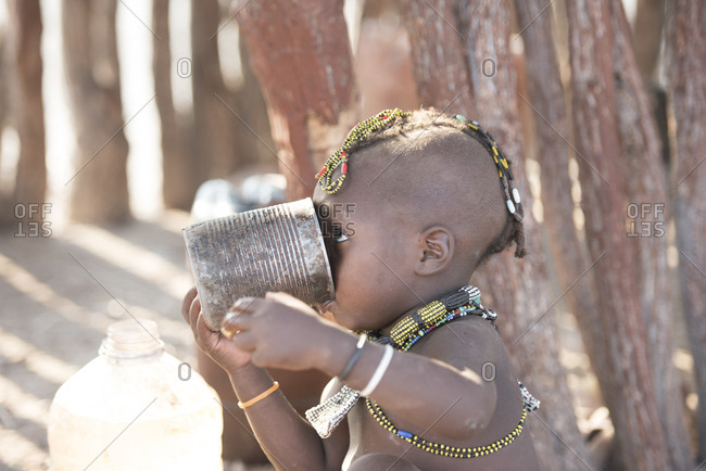 Close-up of girl drinking water