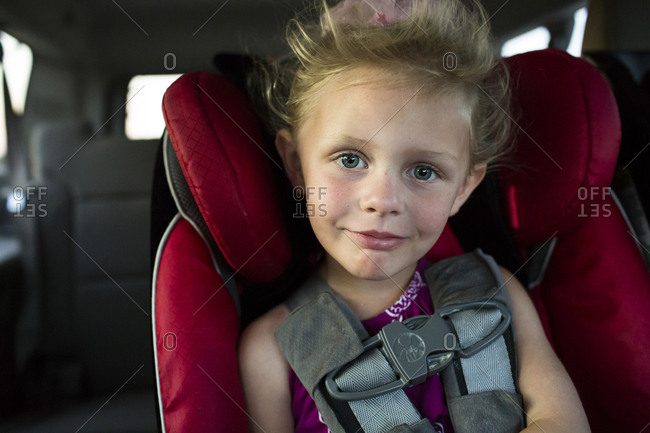 Portrait of smiling girl traveling in car