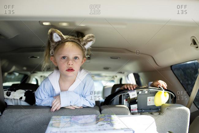 Portrait of girl wearing headband traveling in car