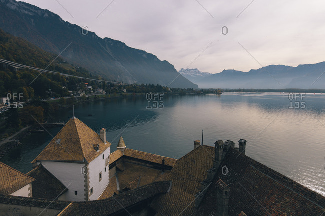High angle view of Chillon Castle by Lake Geneva against cloudy sky